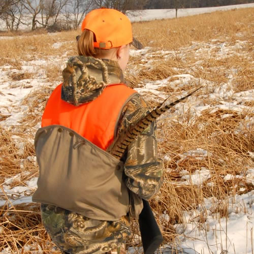 kid with pheasant hunting